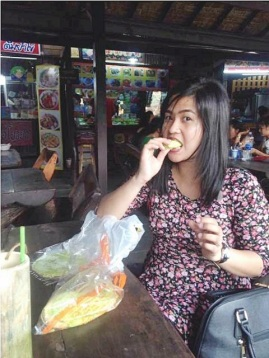 Abby eating the famous roti sai mai